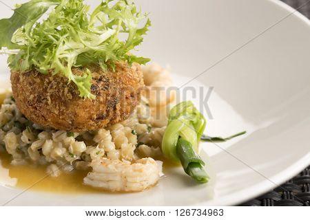 Langoustines, Pork belly beignet, pearl barley & shellfish butter