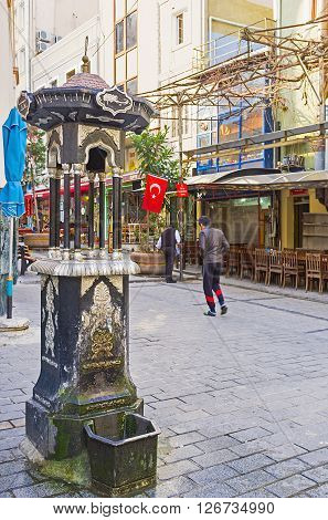 ISTANBUL TURKEY - JANUARY 21 2015: The tiny ablution fountain next to the entrance to the Hamidiye Turbesi (tombs) on January 21 in Istanbul.