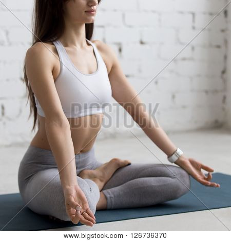 Yoga Indoors: Half Lotus Posture