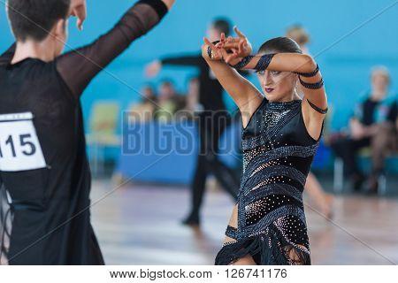 Minsk Belarus -April 3 2016: Silich Sergey and Borovskaya Olga Perform Youth Latin-American Program on IDSA Championship Kinezis Star Cup - 2016 in April 3 2016 in Minsk Republic of Belarus