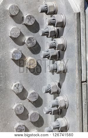 Nuts and bolts on a steel structure.