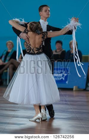 Minsk Belarus -April 3 2016: Ermolovich Konstantin and Snegir Anna Perform Youth-2 Standard Program on the IDSA Championship Kinezis Star Cup in April 3 2016 in Minsk Republic of Belarus