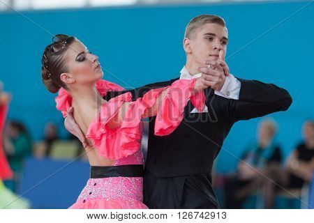 Minsk Belarus -April 3 2016: Dubovik Timofey and Zagrebailova Yana Perform Youth-2 Standard Program on the IDSA Championship Kinezis Star Cup in April 3 2016 in Minsk Republic of Belarus