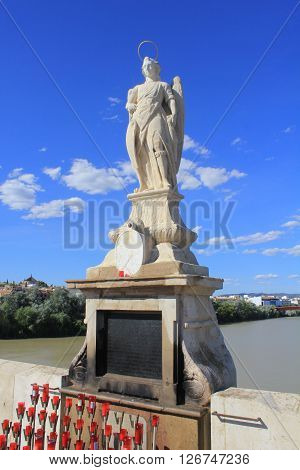 San Rafael Archangel Statue located in the Roman bridge in Cordoba - Spain.
