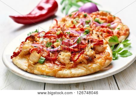 Pie with chicken meat and vegetables on white plate
