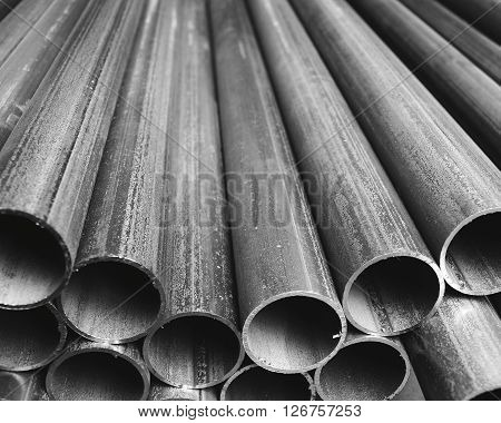 Folded industrial grey plastic tubes lines background