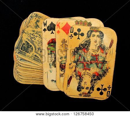 Vintage playing cards deck at black background