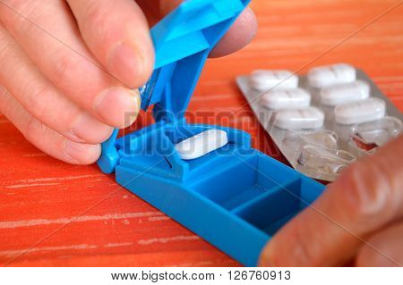 Tablets and drugs are divided - closeup