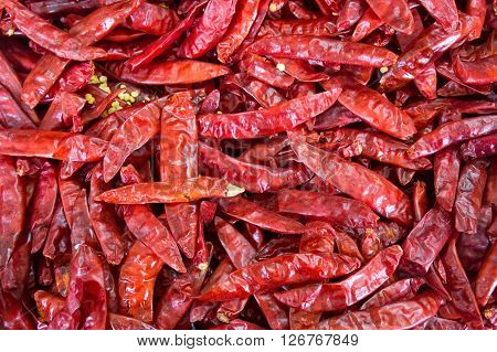 Lot of dried chili as a food background. Chili Pepper. Red dry Chili pepper background. Hot red chili pepper on market at Vegetable Stall of Local Market, Little India, Singapore.