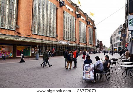 The Hague Netherlands - May 8 2015: People shopping at market street in the center of The Hague Netherlands. The Hague is the third-largest city of the Netherlands