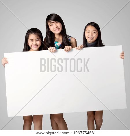 Group of kids showing blank placard board to write it on