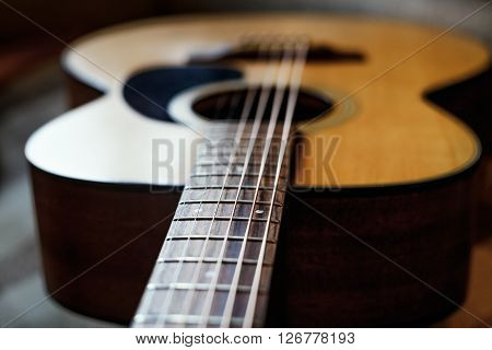 grunge acoustic guitar neck, selective focus on fret