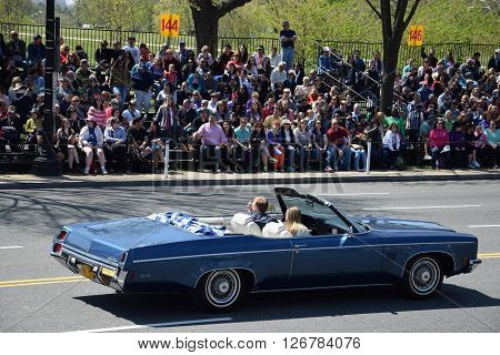 WASHINGTON, DC - APR 16: Convertible car at the 2016 National Cherry Blossom Parade in Washington DC, as seen on April 16, 2016. Thousands of visitors gathered to attend this annual event.