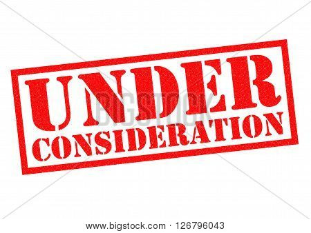 UNDER CONSIDERATION red Rubber Stamp over a white background.