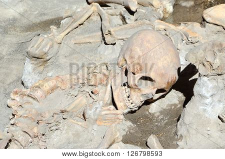 skull of long time ago dead man in the ruins of Ercolano Italy