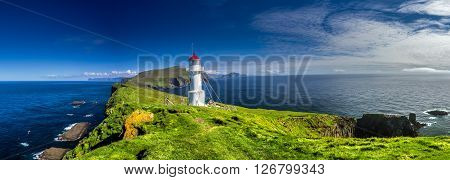 Panoramic view of Old lighthouse on the beautiful island Mykines.