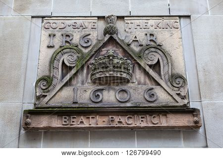One of the old signs from Netherbow Port which once stood on the Royal Mile in Edinburgh. The sign is now displayed on the exterior of the Scottish Storytelling Centre on the Royal Mile. poster