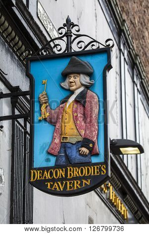 EDINBURGH SCOTLAND - MARCH 12TH 2016: The sign for Deacon Brodies Tavern situated along the Royal Mile in Edinburgh on 12th March 2016. Named after William Brodie one of the inspirations for Robert Louis Stevensons Jekyll and Hyde.