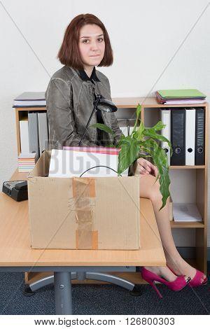 Woman Carrying Office Belongings After Loosing Job