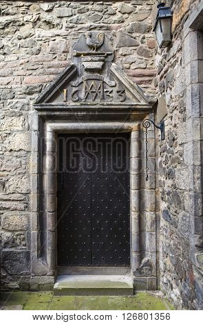 An entrance to Acheson House in the historic city of Edinburgh Scotland. The house was built in 1633 (as the marking above the door notes) and was built for Sir Archibald Acheson Secretary of State of Scotland for King Charles 1st.