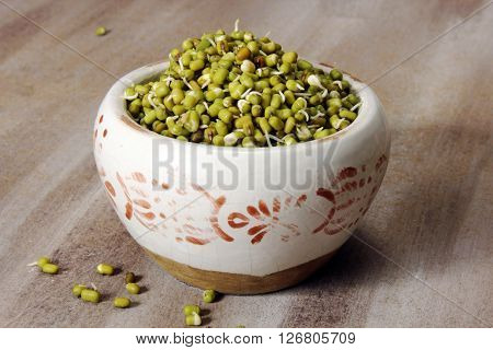Mung beans sprouts in a container selective focus.