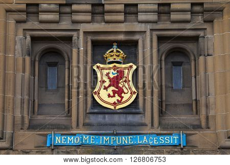 The Lion Rampant crest above the main entrance of Edinburgh Castle in Scotland.