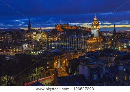 EDINBURGH SCOTLAND - MARCH 9TH 2016: A beautiful view from Calton Hill in Edinburgh taking in the sights of Edinburgh Castle the Balmoral Hotel and Scott Monument on 9th March 2016t.