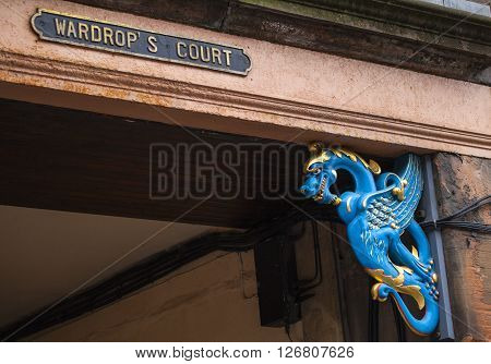 A street sign for the historic Wardrops Court along the Royal Mile in Edinburgh Scotland.
