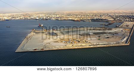 Aerial view on the coast in Namibia and cargo port of the city Walvis Bay in the Namib desert Atlantic ocean Africa