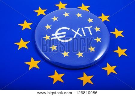 An EXIT Pin Badge displayed over the European Union flag in reference to the upcoming referendum on Britain's membership to the European Union.