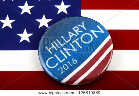 LONDON UK - MARCH 3RD 2016: A Hillary Clinton 2016 pin badge over the US flag symbolising her campaign to become the next President of the United States 3rd March 2016.