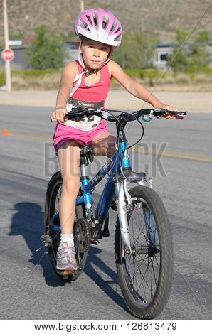 Hemet California/USA-April 17 2016:kid on bike in the Diamond Valley Triathlon