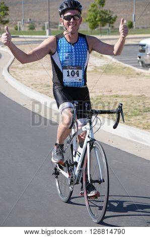 Hemet California/USA-April 17 2016:Athlete on bike in the Diamond Valley Triathlon