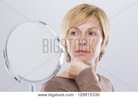 Forty years woman and mirror