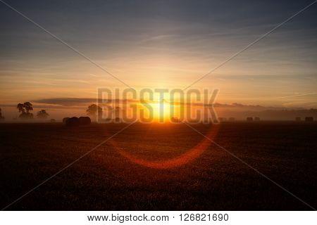 Sunrise over rural landscape