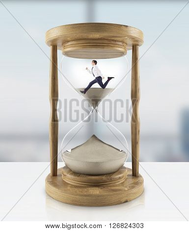 Running businessman in hourglass. 3D Rendering. Close up
