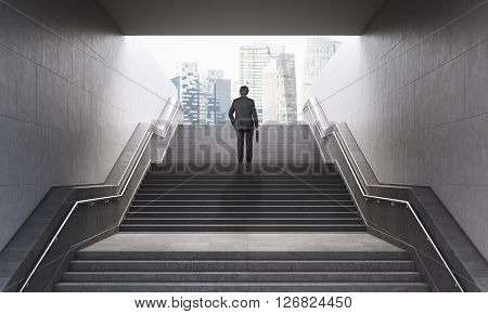 Businessman with briefcase climbing stairs in pedestrian subway going to the city. Concept of success. New York. 3D Rendering