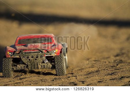 Low angle shot of an RC car kicking up dust