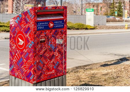 Ottawa Canada - April 15 2016: Red Canada Post mailbox on the street.