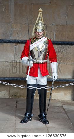 WINDSOR - APRIL 17: Unidentified man, guard protecting entrance to the Whitehall palace on April 17, 2016 in London, United Kingdom.