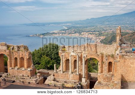 Detail of the Greek Theater with the Giardini Naxos bay in the background in Taormina Sicily Italy