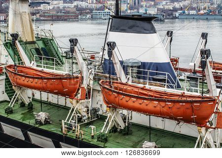 two orange lifeboats on the ship's davits