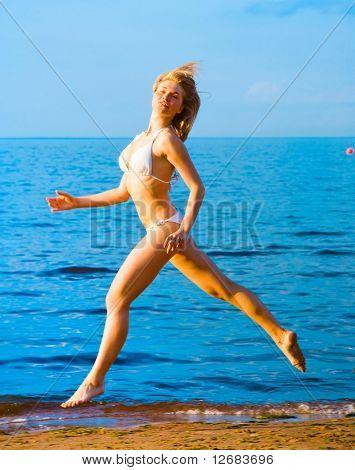 woman running to the setting sun