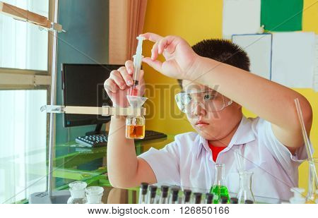 Boyl doing science experiment science Education .
