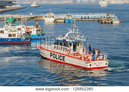 YOKOHAMA JAPAN - NOVEMBER 24 2015: Unidentified Japanese marine police force with watercraft on duty at Yokohama port