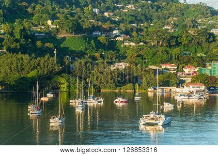 Victoria Mahe island Seychelles - December 15 2015: Beautiful yachts and boats in the morning sun in the harbor of Port Victoria Mahe island Seychelles.