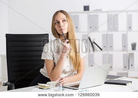 Thinking Businesswoman With Notebook