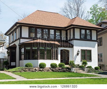 Older Stucco Home with Brown Trim