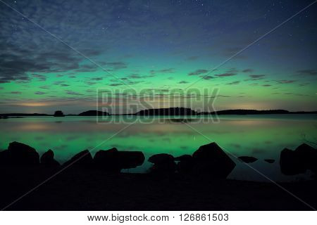 Scenic view of a northern lights over calm lake