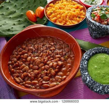 Frijoles mexican beans with rice and sauces nopal and pico de gallo